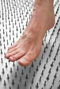 Foot Pain Demonstrated With Bed of Nails